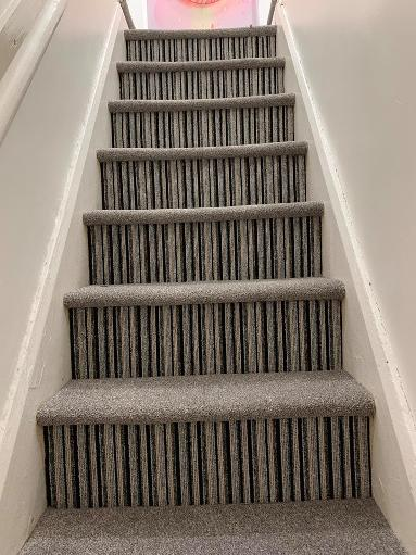 Feature Stairs carpet striped riser and beige carpet on treads